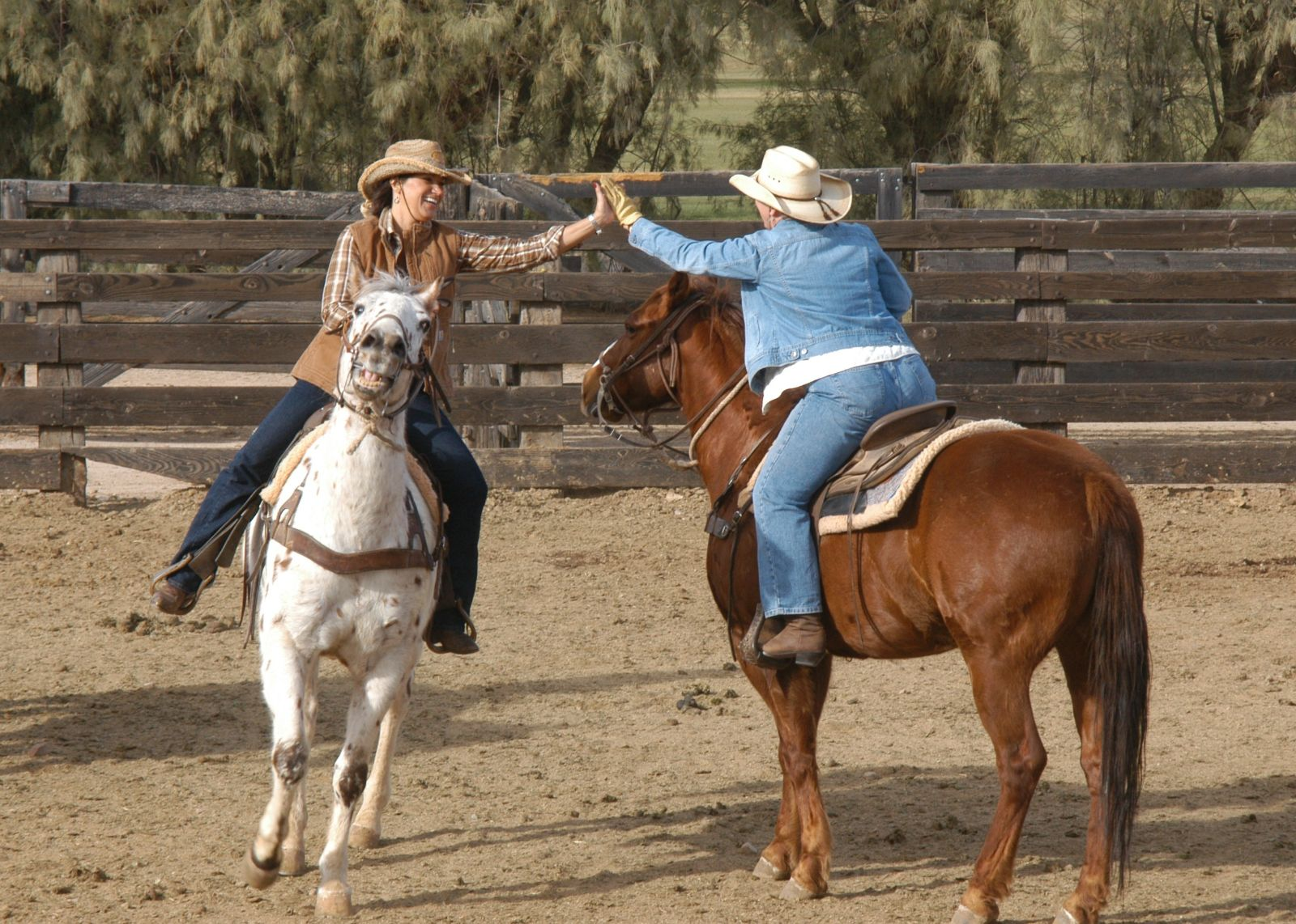 Cowgirls horseback riding at our arizona ranch