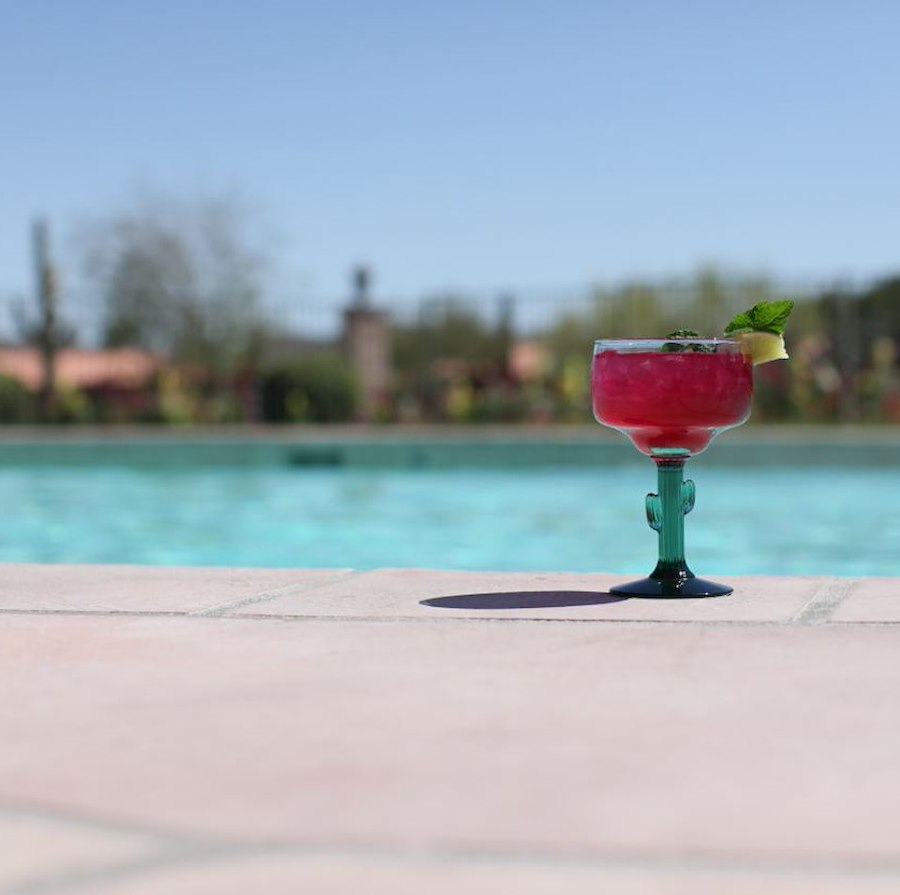 Outdoor pool and Margarita at Rancho de los Caballeros